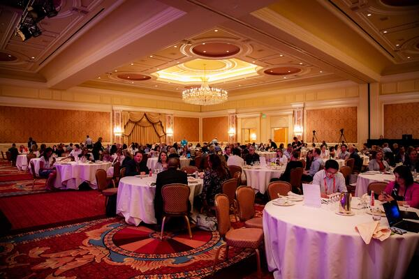 full_room_with_ppl_at_tables